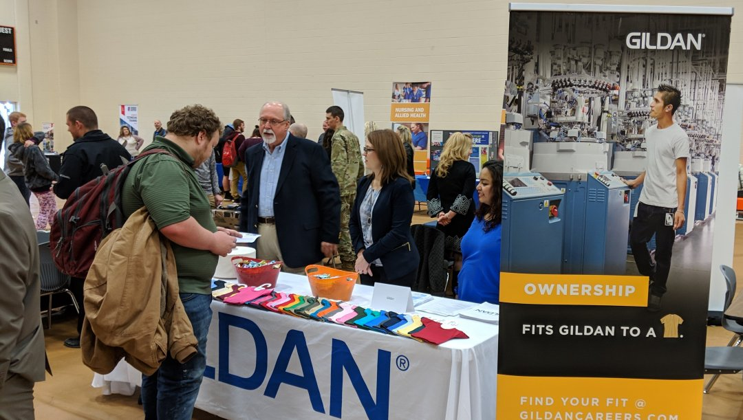 A student learns about career options and opportunities at Gildan during 2019 Career Expo at Davie County High School