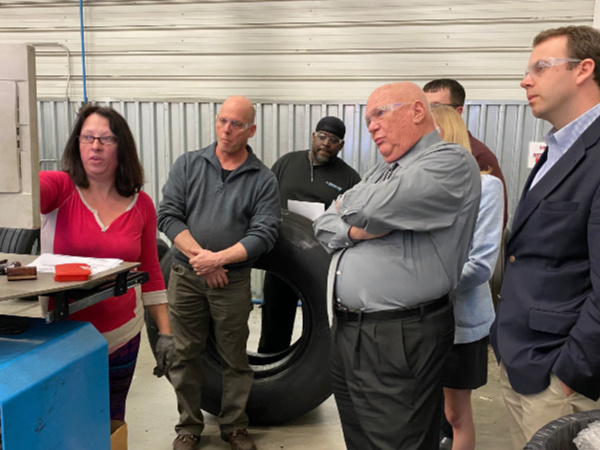 Rose Ellis explains how tires are scanned under high pressure for abnormalities. From Left - Ellis, Ric Wojcik, head of resources for Dunlop Aircraft Tyres; Tommy Plomp; Mike Fenley, field representative for U.S. Senator Richard Burr; Kyle Bridges, district director for U.S. Congressman Ted Budd.